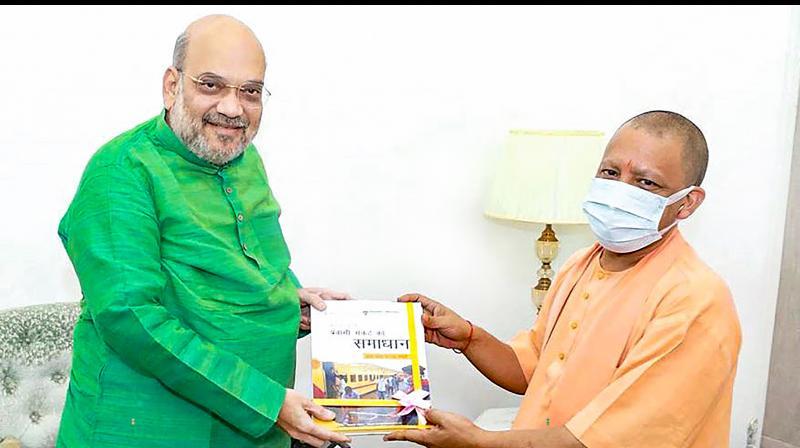 Uttar Pradesh Chief Minister Yogi Adityanath meets Home Minister Amit Shah, in New Delhi. (PTI)