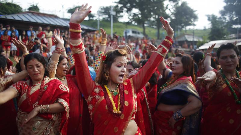 Nepalese Hindu women observe a day-long fast and pray for their husbands and for a happy married life. (Photo:AP)
