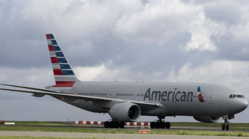 American Airlines spokesman Matt Miller said the company is reviewing the complaints in Shah's lawsuit. (Photo: AFP)