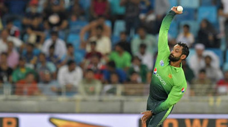 Pakistani all-rounder Mohammad Hafeez has been suspended from bowling in all competitions conducted by England and Wales Cricket Board (ECB) after a bowling-action assessment found his action to be illegal. (Photo:AFP)