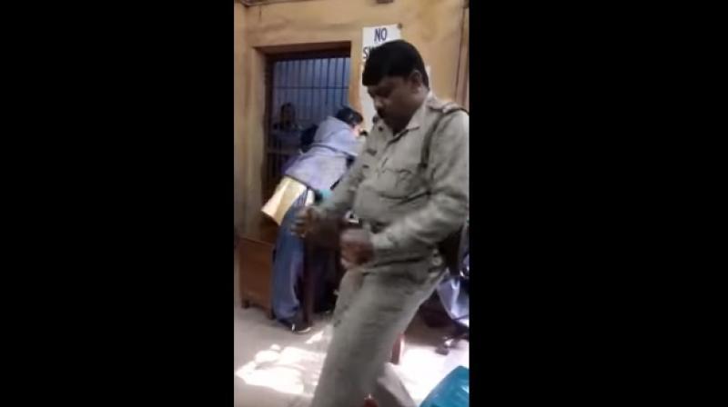 Mondal was celebrating his transfer to the Chittaranjan police station. (Photo: Youtube Screengrab)