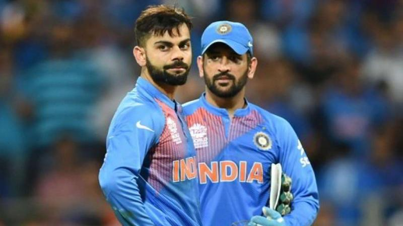 Getting Dhoni's inputs is pure gold and a privilege that he has enjoyed as a skipper, according to Kohli. (Photo: AFP)
