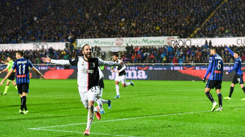 Gonzalo Higuain grabbed a second-half brace to fire Juventus to a 3-1 win at Atalanta that kept the champions top of Serie A, despite Inter Milan's comfortable 3-0 win at Torino that kept them in touch with the leaders. (Photo:AFP)