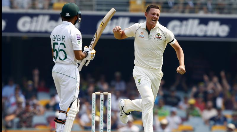 Babar Azam scored a magnificent century and Mohammad Rizwan fell five runs short of his first as Pakistan were dismissed for 335 late on the fourth day. Leg-spinner Yasir Shah also made his highest Test score with a fighting 42 to allow the Pakistanis to head to the second Test in Adelaide with some momentum despite the loss. Josh Hazlewood cliamed the wicket of centurion Babar Azam. (Photo:AP) (Photo:AP)