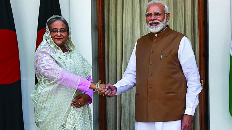 Prime Minister Narendra Modi shakes hands with his Bangladeshi counterpart Sheikh Hasina prior to a meeting at Hyderabad House in New Delhi. (Photo: PTI)