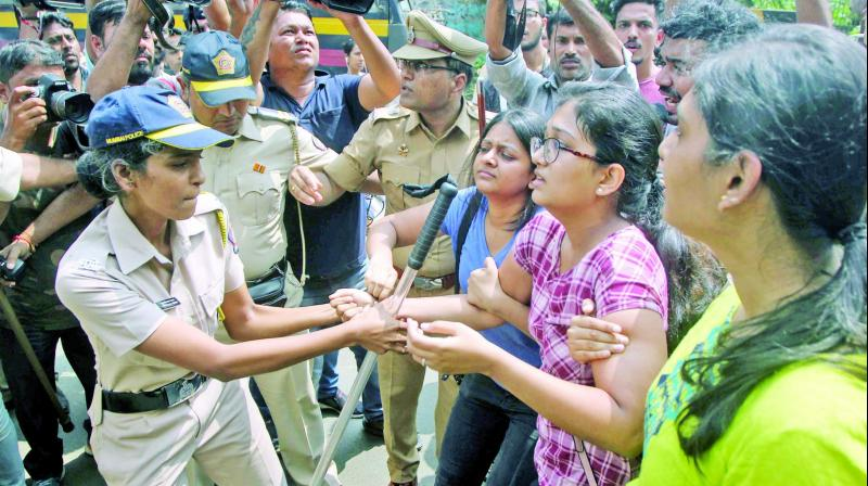 A demonstrator is detained by the police during the protest against tree cutting at Aarey Colony on Saturday. (Photo: Mrugesh Bandiwadekar)