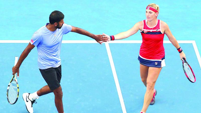 Rohan Bopanna with Timea Babos at the Australian Open mixed doubles finals 2018