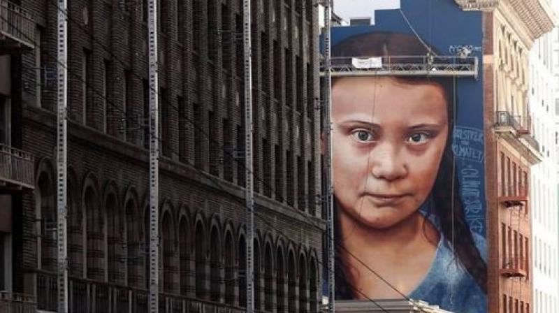Argentine street artist Andres Petreselli, who signs his work Cobre, says the portrait of Thunberg, 16, was unusual because he typically does not address politics, religion or sports. (Twitter | @BarakaMounira)