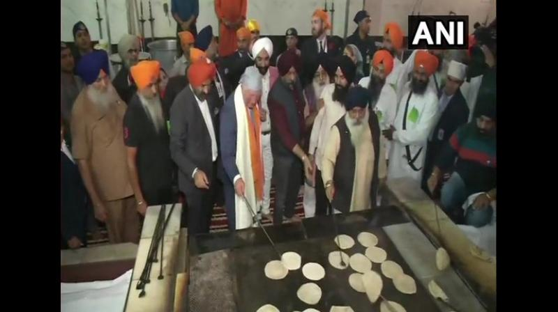 Prince Charles paid obeisance at the Gurudwara and interacted with the Sikhs. Besides, he was seen flipping roties during his visit. (Photo: ANI)