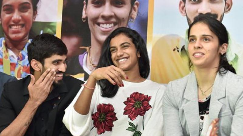 Badminton players Srikanth Kidambi (from left), P.V. Sindhu and Saina Nehwal at a felicitation ceremony in New Delhi. (Photo: PTI)