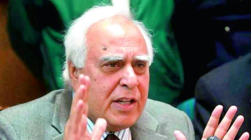Senior Congress leader Kapil Sibal on Tuesday took a swipe at Prime Minister Narendra Modi over Nobel Prize winner Abhijit Banerjee's remarks that the Indian economy is on shaky ground, saying the PM should attend to work and have less