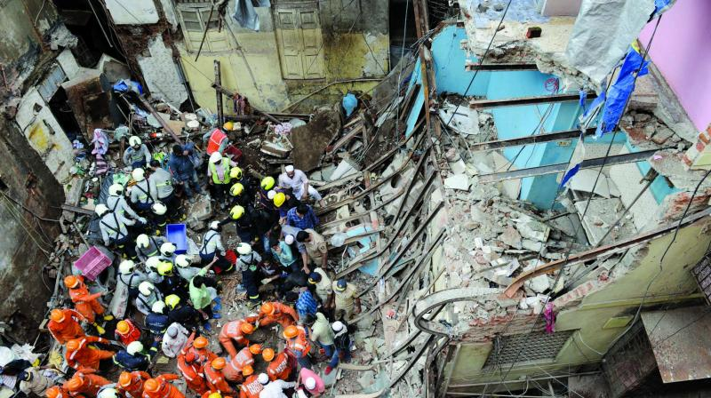 Rescue team at the spot where the four-storey building collapsed in Dongri on Tuesday. (Photo: Rajesh Jadhav)
