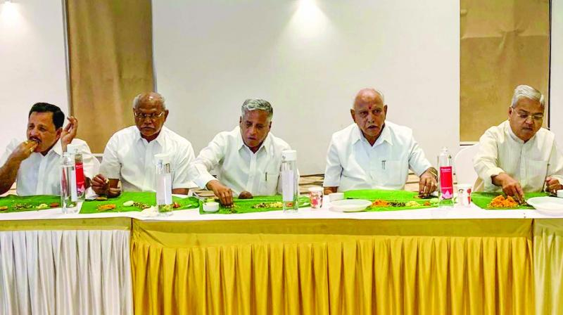 BJP state president B.S. Yeddyurappa with his party leaders and MLAs at a resort in Bengaluru.