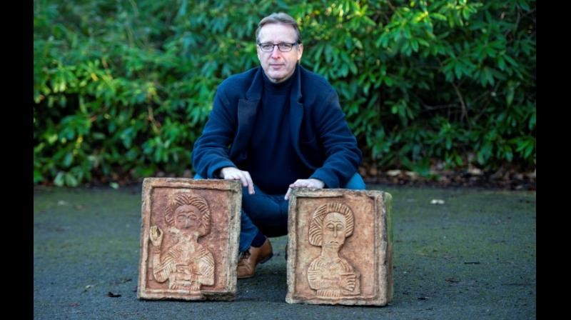 Dutch art detective Arthur Brand with the two recovered stone Visigoth reliefs. (Photo: AFP)