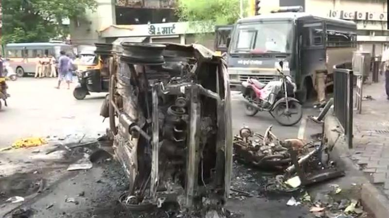 On Wednesday, police had lobbed teargas shells and used baton-charge in Kopar Khairane area after a group of protesters stoned vehicles, clashed with local people and indulged in arson. (Photo: Twitter | ANI)