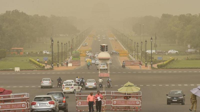 A view of Vijay Chowk and Rajpath during a mild dust storm in New Delhi on Tuesday, June 12, 2018. (Photo: PTI)