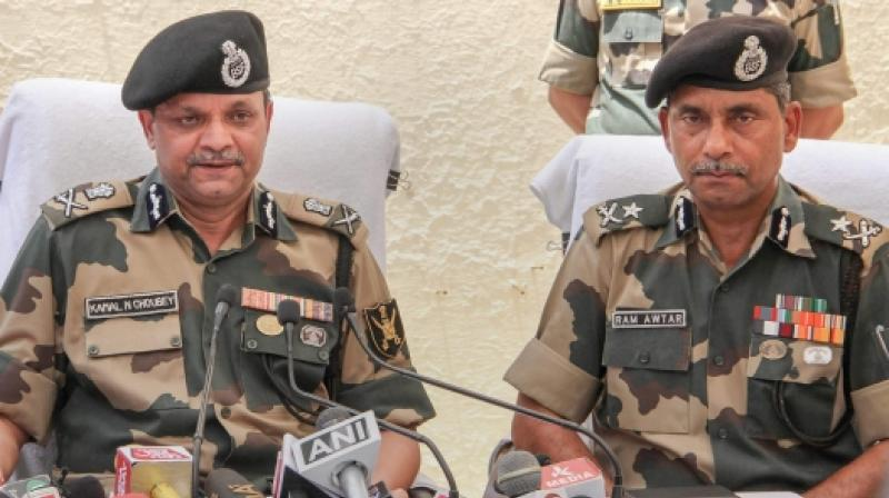 BSF Additional Director General ADG Kamal N Choubey and BSF IG Jammu Ram Awtar address the media at Paloura BSF headquarters in Jammu on Wednesday June 13 2018. (Photo: PTI)