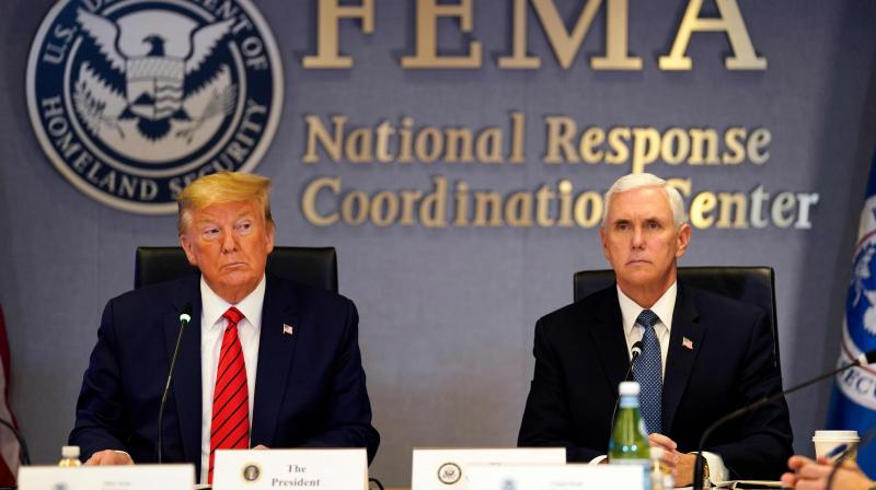 US President Donald Trump speaks next to Vice president Mike Pence during a teleconference with governors at the Federal Emergency Management Agency(FEMA) headquarters in Washington,DC. AFP Photo