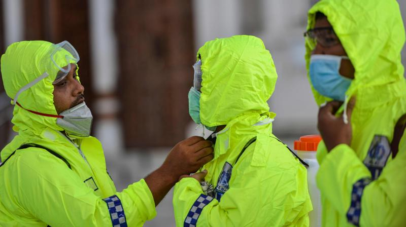 Indonesian police prepare to spray disinfectant in the Baiturrahman grand mosque, amid concerns of the COVID-19 coronavirus, in Banda Aceh. AFP Photo