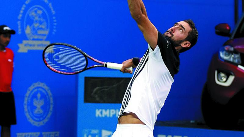 Croatia's Marin Cilic in action against Pierre-Hugues Herbert of France in their Tata Open quarter-final in Pune on Thursday. Cilic won 6-3, 6-2.