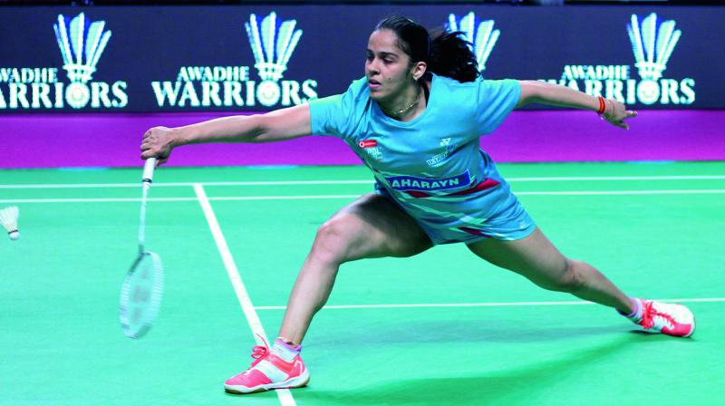 Awadhe Warriors' Saina Nehwal en route to her 8-15, 15-10, 15-13 win over Beiwen Zhang of Mumbai Rockets in their PBL match in Lucknow on Thursday.