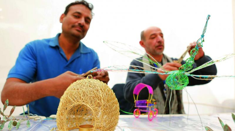 Wire artist Mohammad Rafiq with Nahid Dabeet.