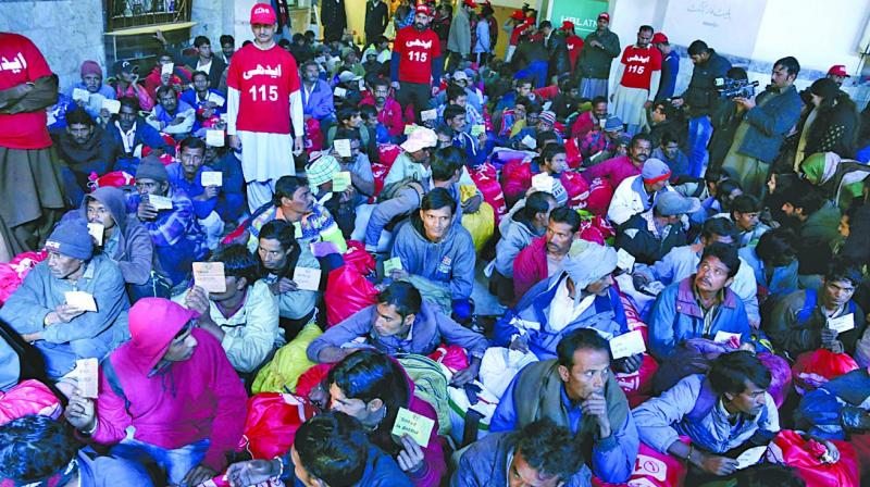 Released Indian fishermen wait at Lahore railway station to leave for India. (Photo: AP)