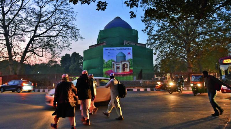 Pedestrians cross the Sabz Burj roundabout near the  Humayun's Tomb in New Delhi. (Photo: PTI)