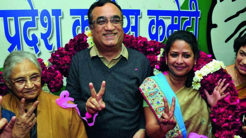Former chief minister Sheila Dikshit, DPCC president Ajay Maken and newly-appointed Delhi Mahila Congress president Sharmishtha Mukherjee pose for a picture in New Delhi. (Photo: Bunny Smith)