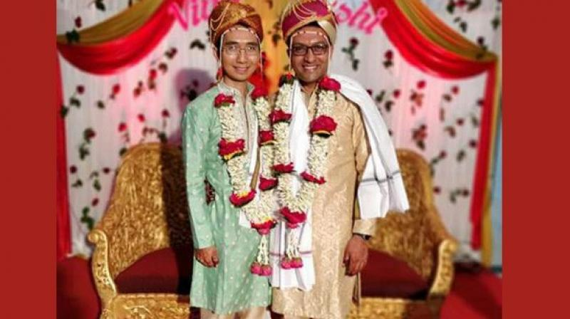 With the blessings of their families and friends, Yavatmal native Hrishi Mohankumar Sathawane (40) married Vinh, from Vietnam at a hotel a few distance away from the office of the Superintendent of Police. (Photo: ANI)