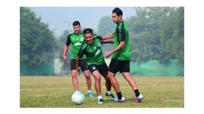 Bengaluru FC's Sunil Chhetri (centre) at a training  session in New Delhi on Saturday.