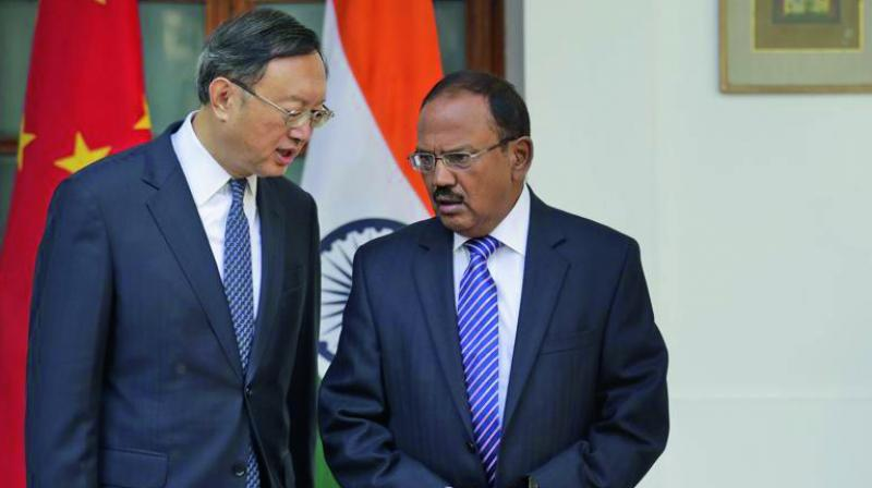 National security adviser Ajit Doval (right) talks with Chinese state councillor Yang Jiechi before their delegation-level meeting in New Delhi on December 22. Special representatives of India and China held the 20th round of negotiations on the border issues. The meeting came four months after the forces of the two sides confronted each other at the Doklam plateau. (Photo: AP)