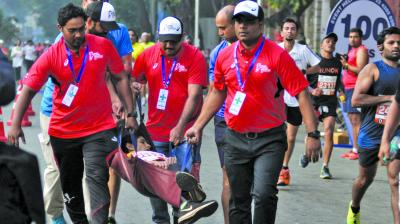 Volunteers taking away a injured participant.