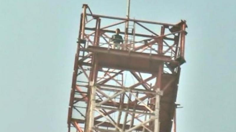Upendra Singh Rathore climbed the 350-feet tall tower, saying he will descend only when the movie is banned across the country. (Photo: ANI)