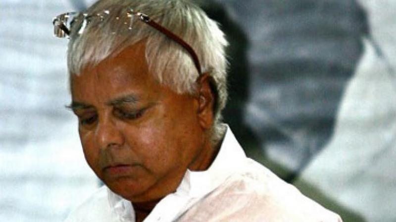 Lalu Prasad Yadav could not attend the engagement but Tej took to Twitter to express his feelings about his father's absence from the ceremony. (Photo: AFP | File)