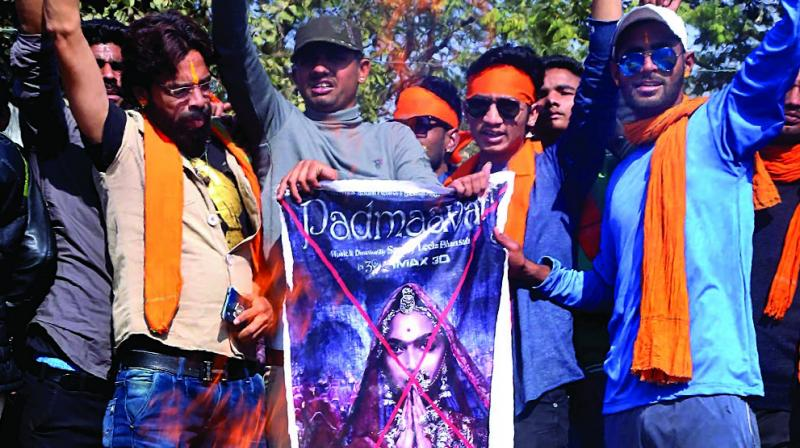Members of Karni Sena burn posters of Padmaavat during a protest against the release of the film at Beawar in Rajasthan. (Photo: PTI)
