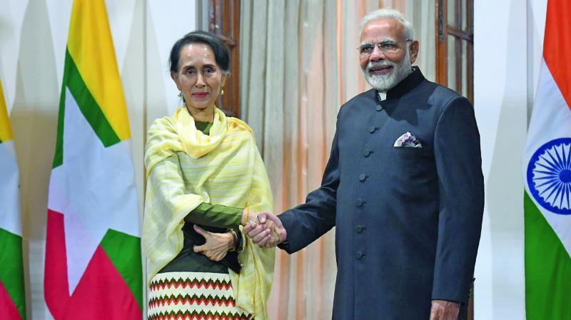 PM Narendra Modi (R) with Myanmar's State Counsellor Daw Aung San Suu Kyi in New Delhi. (Photo: AFP)