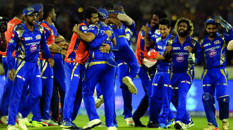 Former Mumbai Indians team players celebrate their victory against Rising Pune Supergiants after the 2017 IPL Twenty20 final cricket match.