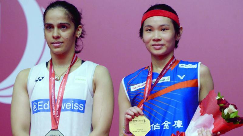 Saina Nehwal and Taiwan's Tai Tzu Ying pose on the podium. (Photo: AFP)