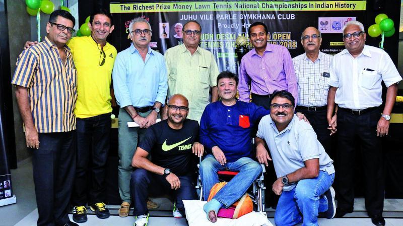 Himanshu Gokani (seated centre), Hon Secretary of JVPG Club, Chetan Desai (3rd left) brother of Anirudh Desai, and other members of the organising committee.