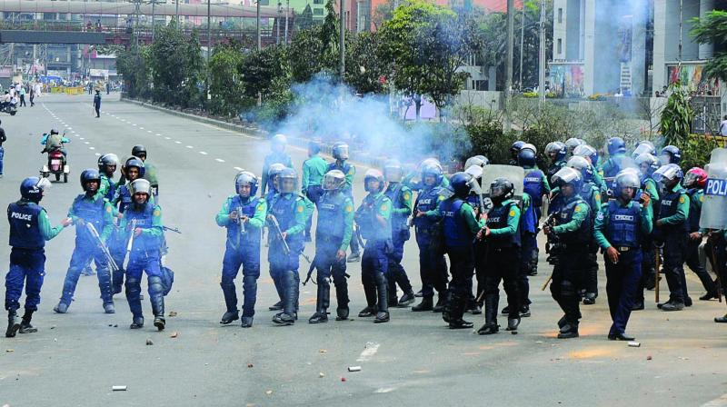 Security personnel use teargas to disperse former Prime Minister Khaleda Zia's supporters protesting against the court verdict in Dhaka on Thursday. (Photo: AP)