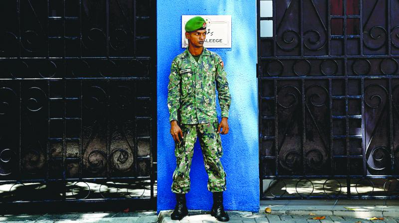 A Maldives soldier stands guard outside the President's residence in Male on on Thursday. The international community has censured Maldives President Abdulla Yameen for imposing special Emergency provisions that allow the military to detain suspects for long periods without charge. — AFP The UN has urged Yameen to lift the state of emergency, and will discuss the crisis gripping the Indian Ocean archipelago in a closed-door meeting at the Security Council on February 8.  (Photo: AFP)