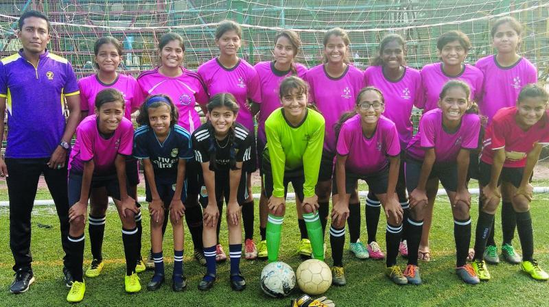 Winners of the NMASA Inter-school Under-16 Girls Football Tournament St. Augustine High School, Nerul with their coach Abhishek Dey.