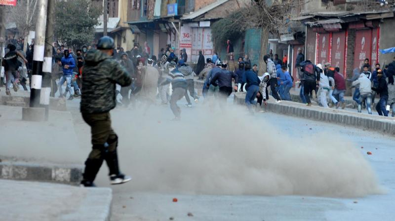 Stone-pelting Kashmiri youth clash with security forces in Nawakadal, old city area of Srinagar, on Friday, the eve of the death anniversary of Parliament attack convict Afzal Guru. (Photo: H U Naqash)