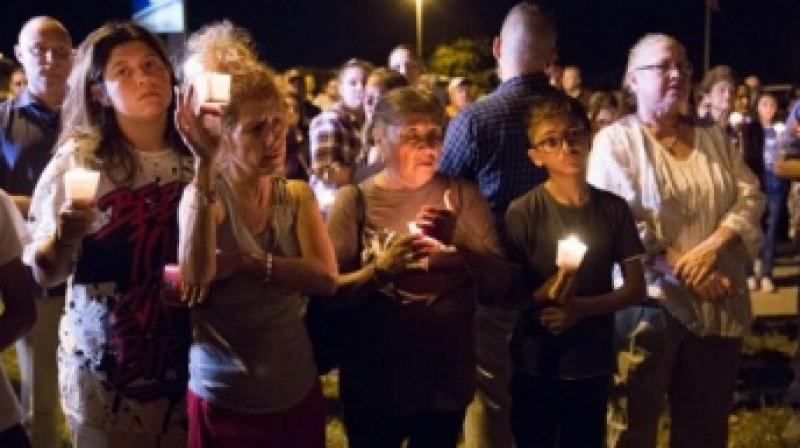 A candlelight vigil being observed following the mass shooting at the First Baptist Church in Sutherland Springs, Texas, that left 26 people dead. (Photo: AFP)