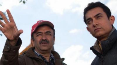 Aamir Khan cover picture with Rajkumar Hirani on Twitter.