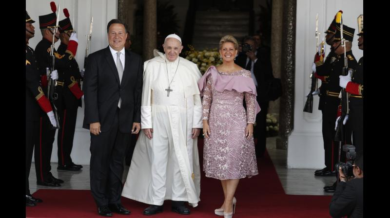 Pope Francis, Panama's President Juan Carlos Varela and first lady Lorena Castillo pose for a photo at entrance of the presidential palace in Panama City. (Photo: AP)