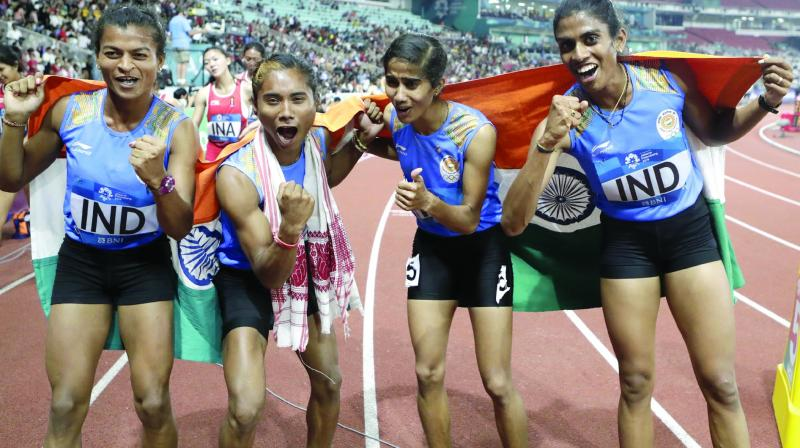 India's 4x400m women's relay team celebrate after winning gold on Thursday.