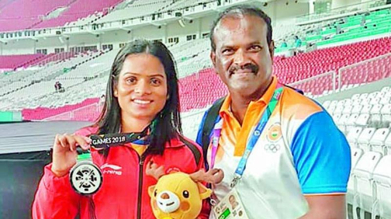 Dutee Chand poses with her coach N. Ramesh after winning her second silver at Asian Games.