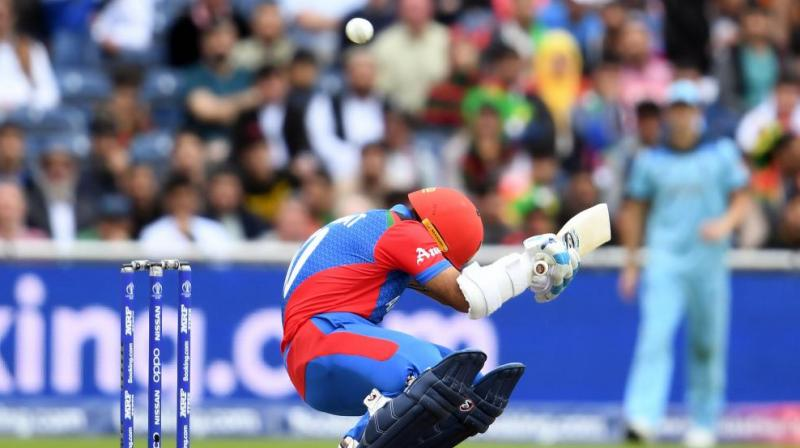 Afghanistan's Hashmatullah Shahidi has said he disregarded medical advice and kept on batting after taking a bouncer to the helmet in Tuesday's World Cup defeat by England because he did not want his mother to worry. (Photo:AFP)